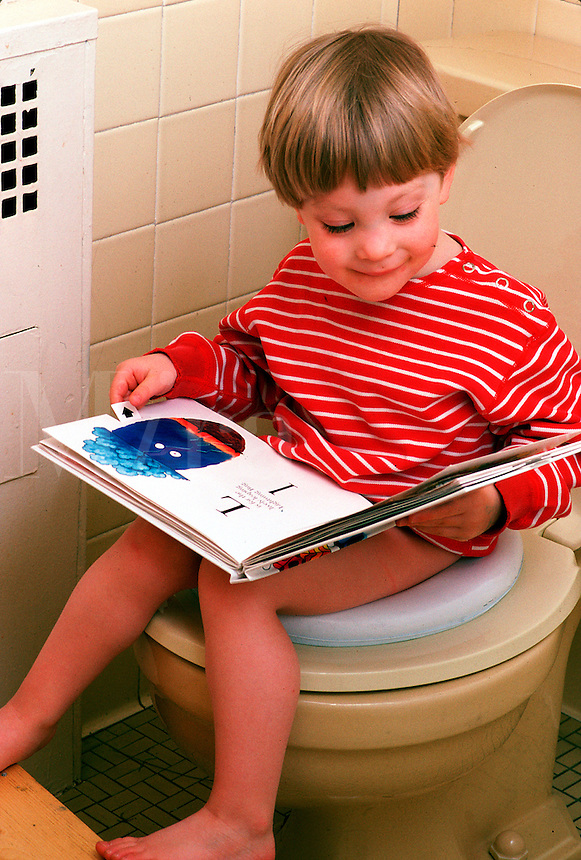 Young boy toilet trains.