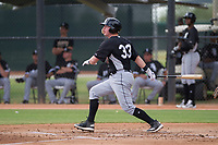 Chicago White Sox catcher Zach Collins (33) follows through on his swing during an Instructional League game against the San Diego Padres on September 26, 2017 at Camelback Ranch in Glendale, Arizona. (Zachary Lucy/Four Seam Images)