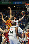Real Madrid´s Sergio Llull and Marcus Slaughter and Galatasaray´s Gonlum during 2014-15 Euroleague Basketball match between Real Madrid and Galatasaray at Palacio de los Deportes stadium in Madrid, Spain. January 08, 2015. (ALTERPHOTOS/Luis Fernandez)