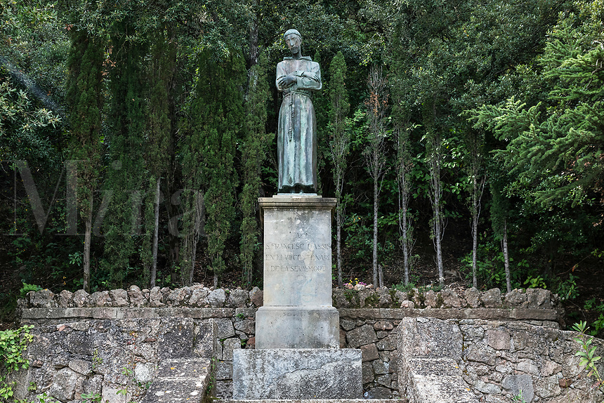 Statue of St Francis of Assisi on the grounds of Santa Maria de Montserrat Abbey, Monistrol de Montserrat,  Catalonia, Spain.