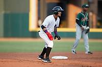 Jose Rodriguez (24) of the Winston-Salem Dash takes his lead off of second base against the Greensboro Grasshoppers at Truist Stadium on August 13, 2021 in Winston-Salem, North Carolina. (Brian Westerholt/Four Seam Images)