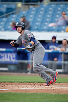 Lehigh Valley IronPigs catcher Logan Moore (35) follows through on a swing during a game against the Syracuse Chiefs on May 20, 2018 at NBT Bank Stadium in Syracuse, New York.  Lehigh Valley defeated Syracuse 5-2.  (Mike Janes/Four Seam Images)