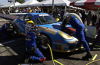 .The winning Racer's Group Porsche make its final stop for tires and fuel...