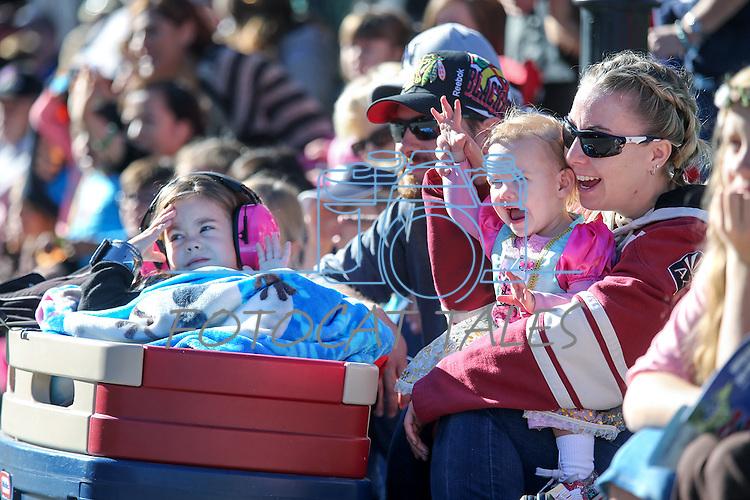 Kris and Dana Swarms and their kids Anova, 4, and Kyra, 18-months, watch the Nevada Day parade in Carson City, Nev., on Saturday, Oct. 31, 2015. <br /> Photo by Cathleen Allison