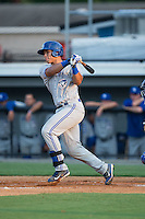 Matt Morgan (7) of the Bluefield Blue Jays follows through on his swing against the Burlington Royals at Burlington Athletic Park on June 29, 2015 in Burlington, North Carolina.  The Royals defeated the Blue Jays 4-1. (Brian Westerholt/Four Seam Images)