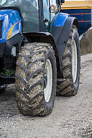 Four wheel drive tarctor wheels on farm roadway