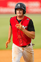 Mark Haddow (21) of the Kannapolis Intimidators hustles towards third base against the Rome Braves at CMC-Northeast Stadium on August 5, 2012 in Kannapolis, North Carolina.  The Intimidators defeated the Braves 9-1.  (Brian Westerholt/Four Seam Images)