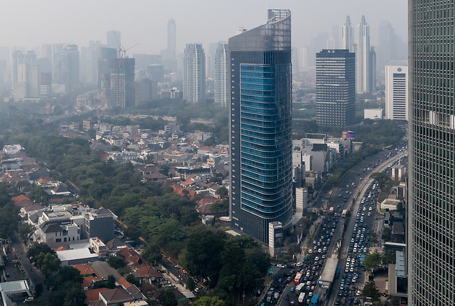 15 August  2019, Jakarta ,Indonesia : Air pollution in downtown Jakarta where the AQI reading this morning was in excess of 200 today. A healthy reading is defined as 50 or lower. Air pollution is a major issue in Jakarta, consistently ranked one of the most polluted cities in the world. Health affected citizens have launched a legal challenge against the city government in a bid to force the Jakarta Governor to address the problem immediately. Picture by Graham Crouch/The Telegraph