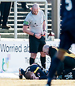 Referee Bobby Madden sends off Albion's Barry Russell as he receives treatment after being injured challenging Arbroath's Ross Chisolm.