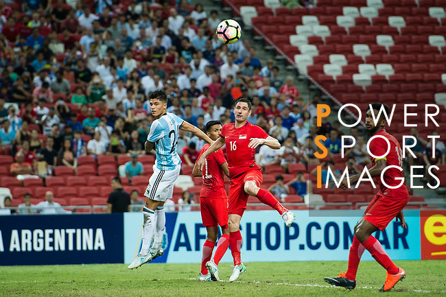 Carlos Correa of Argentina (L) fights for the ball with Daniel Bannett of Singapore (C) during the International Test match between Argentina and Singapore at National Stadium on June 13, 2017 in Singapore. Photo by Marcio Rodrigo Machado / Power Sport Images