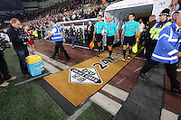 Pictured: Referees and players come out of the tunnel. Tuesday 23 September 2014<br />