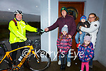 On yer Bike - Fr Patsy Lynch delivers Shamrock to his parishioners in the Dioceses of Prior, Ballinskelligs pictured here the O'Sullivan family front l-r; Marie & Sarah, back l-r; Garry, Callum & Karolina.