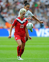Celia Okoyino da Mbabi (r) of Germany and Sophie Schmidt of Canada during the FIFA Women's World Cup at the FIFA Stadium in Berlin, Germany on June 26th, 2011.