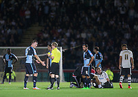 Garry Thompson of Wycombe Wanderers is shown a yellow card for a challenge on Jack Grimmer of Fulham which leaves the player injured during the Capital One Cup match between Wycombe Wanderers and Fulham at Adams Park, High Wycombe, England on 11 August 2015. Photo by Andy Rowland.