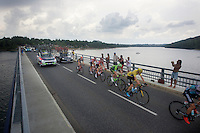 yellow jersey Chris Froome (GBR/SKY) over the bridge of the Lac de Pareloup<br /> <br /> stage 14: Rodez - Mende (178km)<br /> 2015 Tour de France