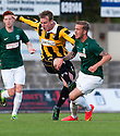 Hibs' Danny Handling is caught late on the side of the knee by East Fife's Alan Walker.