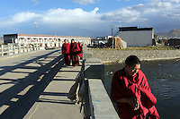 Tibetan monks in the town of Sershul on the Tibetan Plateau, in western China. The town is home to a large monastery which houses thousands of monks. The Sanjiangyuan or Three Rivers Headwater region of western China contains the sources of the Yangtze, Mekong and Yellow Rivers.