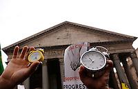 """Manifestazione a sostegno della legge sulle unioni civili in discussione nei prossimi giorni al Senato, a Roma, 23 gennaio 2016.<br /> Protesters hold alarm clocks during demonstration in favor of civil unions rights, including gay couples, ahead of a parliamentary debate, in Rome, 23 January 2016. The sign reads """"It's time to be civil"""". <br /> UPDATE IMAGES PRESS/Riccardo De Luca"""