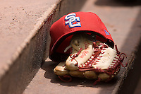 The cap and glove of Lastings Milledge #20 of the Syracuse Chiefs sits on the dugout steps at Knights Castle May 3, 2009 in Fort Mill, South Carolina. (Photo by Brian Westerholt / Four Seam Images)