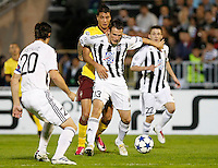 Fudbal, Champions league,Group H season 2010/2011.Partizan Vs. Arsenal.Marko Jovanovic, center in action against Marouane Chamakh, beg=hind, Mladen Krstajic, left.Beograd, 29.09.2010..foto: Srdjan Stevanovic/Starsportphoto ©