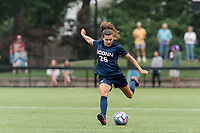 NEWTON, MA - AUGUST 29: Cara Jordan #26 of University of Connecticut passes the ball during a game between University of Connecticut and Boston College at Newton Campus Soccer Field on August 29, 2021 in Newton, Massachusetts.