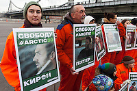 """Moscow, Russia, 05/10/2013.<br /> A Greenpeace activist holds a portrait of British video journalist Kieron Bryan at a demonstration in support of the crew members of the ship """"Arctic Sunrise"""" . The entire crew and accompanying journalists including Bryan have been charged with piracy after being seized at gunpoint by Russian coastguards while protesting at a Gazprom off-shore drilling platform In the Arctic."""