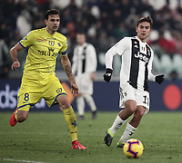 Calcio, Serie A: Juventus - Chievo Verona, Turin, Allianz Stadium, January 21, 2019.<br /> Juventus' Paulo Dybala (r) in action with Chievo's Ivan Radovanovic (l) during the Italian Serie A football match between Juventus and Chievo Verona at Torino's Allianz stadium, January 21, 2019.<br /> UPDATE IMAGES PRESS/Isabella Bonotto