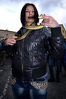 """people of Cocullo with snakes in hand before the procession.The feast of snakes. Process dedicated to the Saint Dominic, in the streets of Cocullo, in the Abruzzo region, Italy on May 1, 2019.<br /> <br /> <br /> <br /> The St. Domenico's procession in Cocullo, central Italy. Every year on the first  of May, snakes are placed onto the statue of St. Domenico and then the statue is carried in a procession through the town. St. Domenico is believed to be the patron saint for people who have been bitten by snakes:<br /> <br /> Italy, Cocullo, in the Province of L'A...quila, is at 870 meters a.s.l., along the railway line connecting Sulmona to Rome. The village rises alongside Mount Luparo (1327 meters) """"The valley opening in front of the village is surrounded by bare rocks, while on the other side, to the south, snow-capped mountain crests follow one after the other...""""<br /> San Domenico Abate lived in the 10th and 11th centuries AD. Born in Foligno, in the Umbria region, he started his pilgrimages, preaching and ascetic practices in Central Italy, making miracles recorded by the word-of-mouth tradition. He died on 22 January 1031 and was buried in Sora.<br /> <br /> Cocullo snake charmers are over with their snake hunting. They proceeded through the During the procession on the first in May, before the snakes are placed all over the statue of St. Dominick, they will be fed with milk kept in containers with crusca. It is the snake that, most of all other elements, expresses an ancestral myth: the unknown aspect and unpredictability of the natural environment with man's innate need to achieve the dominance on his own habitat. <br /> <br /> Snakes and wolves were the emblems of Italic peoples like the Marsians and Irpinians. Some areas in Abruzzo, especially in the Sagittario valley, were under the menace of wolves and snakes, which for the local populations represented the uncertainty and anxiety of their existence that, together with the precariousness and hardships of"""