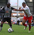 Manny Smith of Notts County challenges with Darius Charles of Stevenage<br />  - Notts County v Stevenage - Sky Bet League One - Meadow Lane, Nottingham - 24th August 2013<br /> © Kevin Coleman 2013