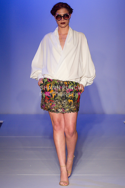 Model walks runway in an outfit from the Ese Azenabor Spring Summer 2016 collection at Fashion Gallery NYFW Spring Summer 2016 show, during New York Fashion Week.