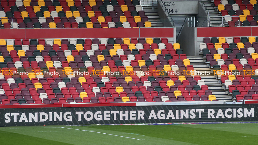 A message around the edge of the Brentford pitch reads, Standing Together Against Racism during Brentford vs Birmingham City, Sky Bet EFL Championship Football at the Brentford Community Stadium on 6th April 2021