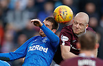 26.01.2020 Hearts v Rangers: Steven Naismith climbs over Jon Flanagan