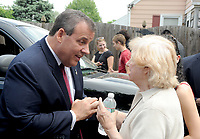 MANVILLE, NJ - MAY 27: New Jersey Governor Chris Christie visits a private residence on Lincoln Avenue to announce a milestone in the Blue Acres buyout program, which purchases homes on flood-prone properties on May 27, 2015 in Manville, New Jersey.<br /> <br /> <br /> People:  New Jersey Governor Chris Christie