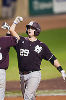 Mississippi State Bulldog catcher Mitch Slauter #29 celebrates at home after hitting a 10th inning home run against the LSU Tigers during the NCAA baseball game on March 16, 2012 at Alex Box Stadium in Baton Rouge, Louisiana. LSU defeated Mississippi State 3-2 in 10 innings. (Andrew Woolley / Four Seam Images)