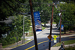 Telephone poles display U.S. flag themed signage in Mahwah, N.J., U.S., on Sunday, August 27, 2016. Photographer: Michael Nagle