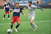 FOXBOROUGH, MA - APRIL 17: Jonathan Bolanos #17 of Richmond Kickers tackles Colby Quinones #41 of New England Revolution II during a game between Richmond Kickers and Revolution II at Gillette Stadium on April 17, 2021 in Foxborough, Massachusetts.