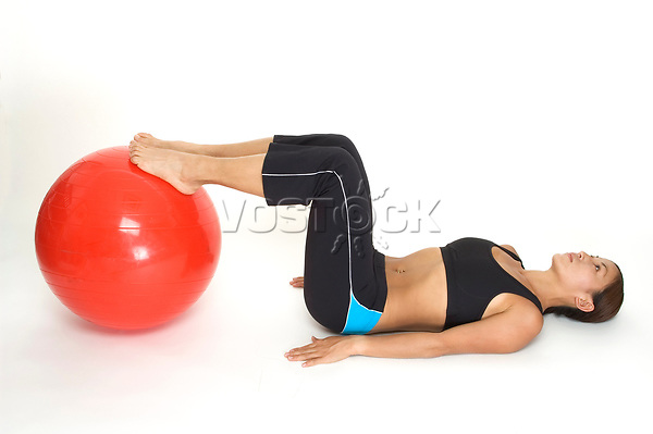 woman showing the start position of a yoga bridge with a gym ball - 01.01.2008  Model-release-yes!