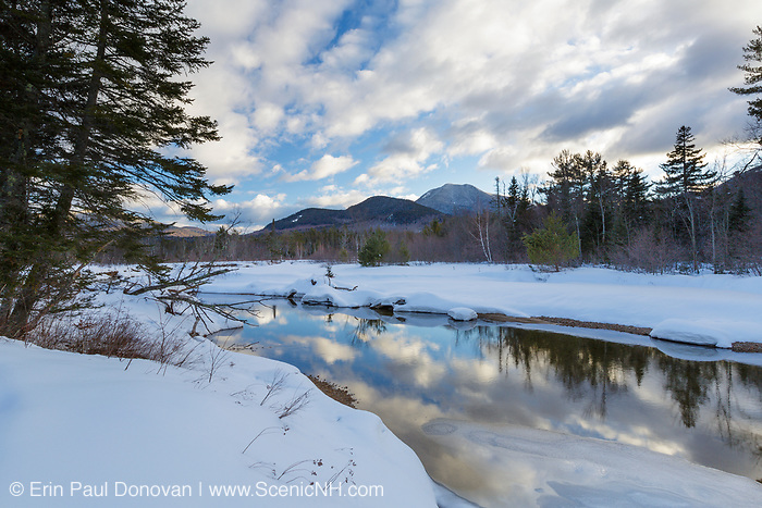 Reflection of clouds in the Swift River in Albany, New Hampshire during the winter months.Mount Passaconaway can be seen off in the distance.