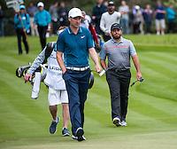 22.05.2015. Wentworth, England. BMW PGA Golf Championship. Round 2. Francesco Molinari [ITA] and Ross Fisher [ENG] walk on to the 18th Green.