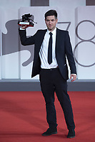 """Director David Adler poses with the Best VR Story Award for """"End Of Night"""" during the Winners Red Carpet as part of the 78th Venice International Film Festival in Venice, Italy on September 11, 2021. <br /> CAP/MPI/IS/PAC<br /> ©PAP/IS/MPI/Capital Pictures"""