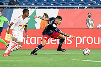 FOXBOROUGH, MA - MAY 22: Gustavo Bou #7 of New England Revolution turns under pressure from Kyle Duncan #6 of New York Red Bulls during a game between New York Red Bulls and New England Revolution at Gillette Stadium on May 22, 2021 in Foxborough, Massachusetts.