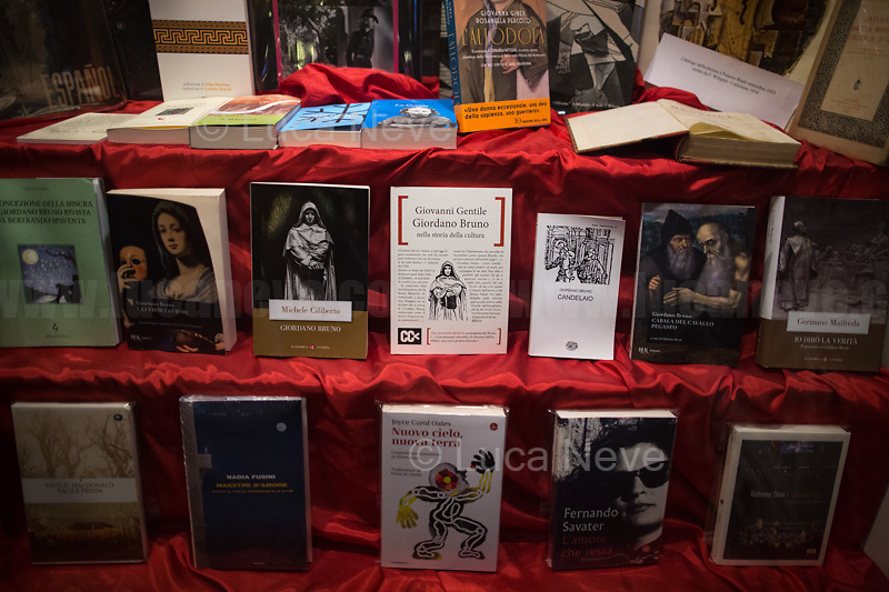 """Bookshop Fahrenheit 451, Campo de' Fiori, Rome.  <br /> <br /> Rome, Italy, 17th Feb, 2021. Today, the Assaciazione Nazionale del Libero Pensiero """"Giordano Bruno"""" (1.), with the participation of a representatives of Comune di Roma (Rome's Municipality) and Comune di Nola (Nola's Municipality), held the 421st Anniversary of the death of Giordano Bruno (2. 3.) in Rome's Campo de' Fiori (4.). On the 17th February 1600 the Dominican friar, Philosopher, mathematician, poet, occultist and cosmological theorist - after being charged of heresy by the Roman Inquisition due to be on denial of several core Catholic doctrines - was burned alive with his tongue in a gag in Rome's Campo dei Fiori. Father of the theories of the Infinite Universe and Worlds, «[…] Bruno's theories influenced 17th-century scientific and philosophical thought and, since the 18th century, have been absorbed by many modern philosophers. As a symbol of the freedom of thought, Bruno inspired the European Liberal movements of the 19th century, particularly the Italian Risorgimento (the movement for national political unity). […] his ethical ideas, in contrast to religious ascetical ethics, appeal to modern humanistic activism; and his ideal of religious and philosophical tolerance has influenced liberal thinkers […]» (5.).<br /> <br /> Footnotes & links:<br /> 1. http://www.periodicoliberopensiero.it/<br /> 2. https://bit.ly/2bBI5th (Wikipedia.org, ENG) <br /> 3. https://bit.ly/2Vb72mI (Treccani.it, ITA)<br /> 4. https://bit.ly/1OU5RzD (Wikipedia.org, ENG)<br /> 5. https://bit.ly/2BvzNQw (Britannica.com, ENG)<br /> 17.02.2019 - Giordano Bruno Anniversary in Rome's Campo de' Fiori (Foto / Video): http://bit.do/fNMSg & https://vimeo.com/318849723"""