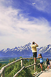 A park visitor does his best to get the best Grand Teton View from Signal Mountain Viewpoint, Grand Teton National Park, United States, Wyoming.