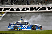 Monster Energy NASCAR Cup Series<br /> Go Bowling 400<br /> Kansas Speedway, Kansas City, KS USA<br /> Saturday 13 May 2017<br /> Martin Truex Jr, Furniture Row Racing, Auto-Owners Insurance Toyota Camry celebrates his win with a burnout<br /> World Copyright: Nigel Kinrade<br /> LAT Images<br /> ref: Digital Image 17KAN1nk10370
