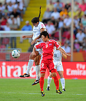 Shannon Boxx (l) of Team USA and Ra Un Sim of Team North Korea during the FIFA Women's World Cup at the FIFA Stadium in Dresden, Germany on June 28th, 2011.
