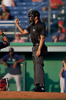 Umpire Justin Juska calls a strike during a NY-Penn League game between the Lowell Spinners and Batavia Muckdogs on July 10, 2019 at Dwyer Stadium in Batavia, New York.  Batavia defeated Lowell 8-6.  (Mike Janes/Four Seam Images)