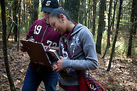 Nelson Torres, 11, (left) and Dayla Olivo, 11, and other sixth grade  students from Roger Williams Middle School in Providence, Rhode Island, walk along a trail at the Powder Mill Ledges Wildlife Refuge in Smithfield, Rhode Island, on Oct. 20, 2011. The students are part of the EcoExplorer program run by the Providence After School Alliance, which helps to kids in learning environments outside of school time.  The students make a weekly visit to the refuge, operated by the Rhode Island Audubon Society, to learn about nature and ecology.<br /> <br /> <br /> M. Scott Brauer for Education Week