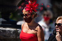 5th September 2020, Louisville, KY, USA;  A spectator wears a derby hat and mask during the 146th Kentucky Derby on September 5, 2020 at Churchill Downs in Louisville, KY.