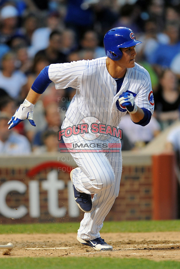 Chicago Cubs first baseman Anthony Rizzo #44 runs to first during a game against the Miami Marlins at Wrigley Field on July 17, 2012 in Chicago, Illinois. The Marlins defeated the Cubs 9-5. (Tony Farlow/Four Seam Images).