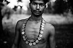 A tribal man is wearing a tribal ornament made of coins. Sukma, Chattisgarh, India. Arindam Mukherjee